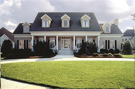 plantation home designs a 2 story 4 bedroom modern plantation style home plan has the traditional symmetrical features