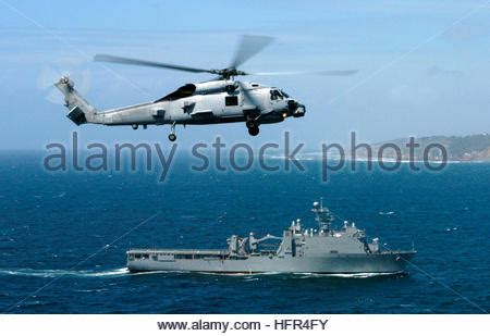 a u.s navy sh 60r seahawk helicopter lands on the flight