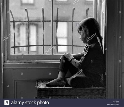 looking out from my lonely room 1960s sad lonely looking out through city apartment window with stock photo royalty free
