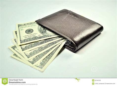 brown wallet and 100 dollar us bills stock photos image