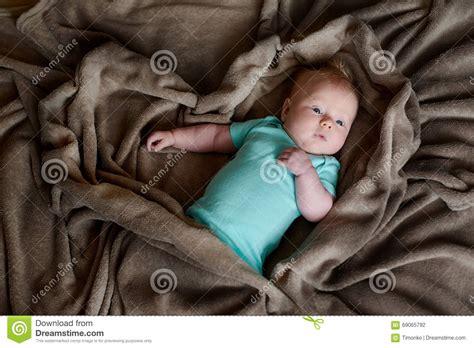 Brown Blanket Kid by Child Boy Is Lying In Bed A Brown Blanket