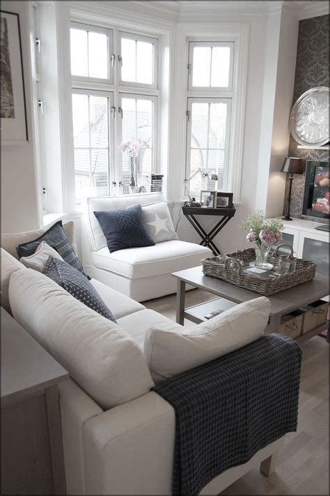 living room with bay window coffee table with baskets above and below also like the