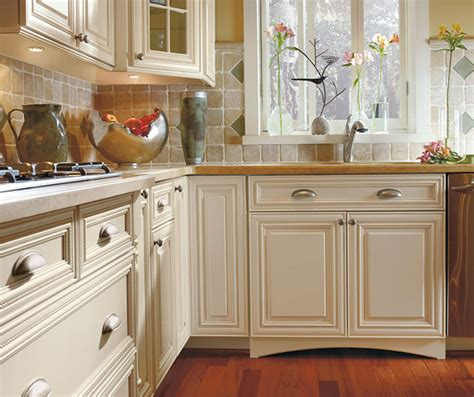 traditional kitchens with white cabinets white cabinets with glaze omega cabinetry