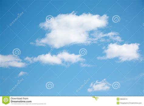 blue clear sky small white clouds on light blue clear sky stock images