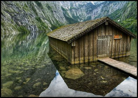 small mountain lake with house over water and forest background fie allo sciliar south tyrol small house of the boatman landscape photos