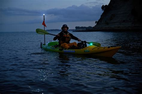 kayak lights for night fishing how to be seen when kayaking at night low light with