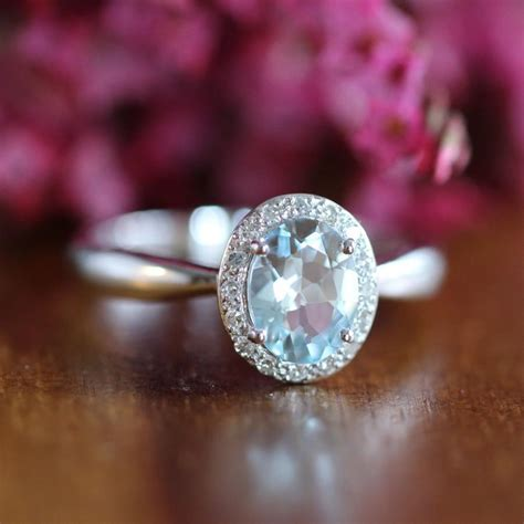 aquamarine halo engagement ring in 14k white gold