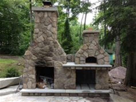 combination outdoor fireplace and grill 1000 images about pizza ovens and fireplaces on