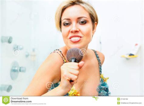 girl singing in bathroom cheerful girl in bathroom singing in fluffy brush royalty