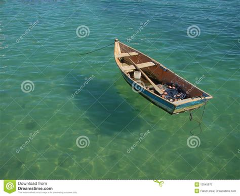 floating boat images row boat floating on the water royalty free stock