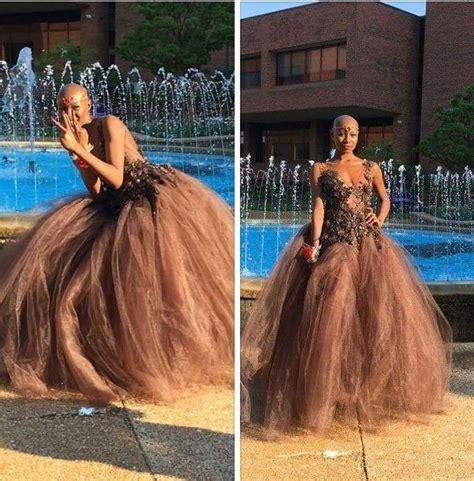 bald women in formal dress brown skin brown dress bronze accessories extreme