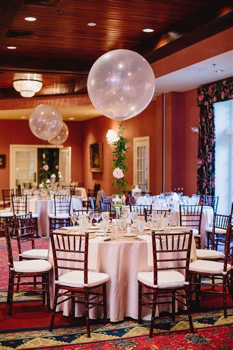 Wedding centerpieces. Balloon centerpieces. Floral garland