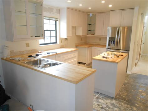 installing cabinets in kitchen kitchen cabinet remodeling should you do it evan spirk