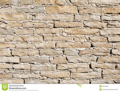 bright as day l limestone wall on a bright sunny day stock photo image