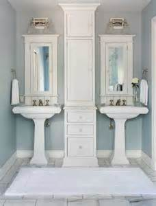 his and her bathroom his and her pedestal sinks transitional bathroom