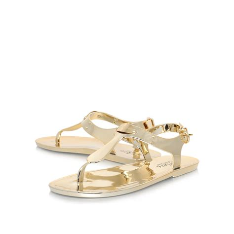 mk jelly sandals michael kors mk plate jelly flat sandals in metallic lyst