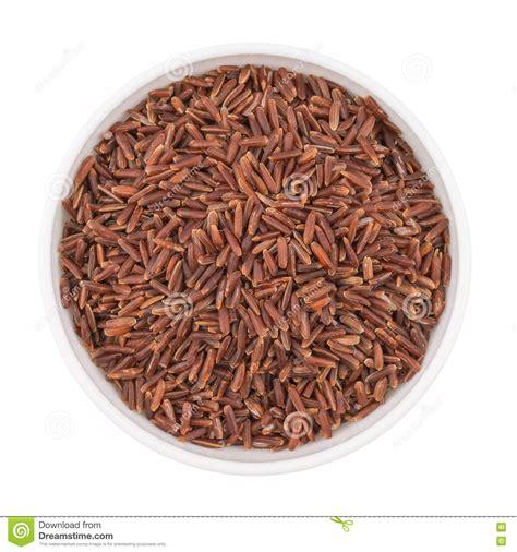 organic light brown rice whole grain organic brown rice in a bowl stock photo