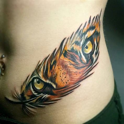 feather tattoo near eye tiger eyes in feather animal tattoo designs pinterest