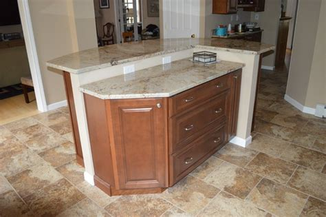 kitchen remodel with two tier island traditional