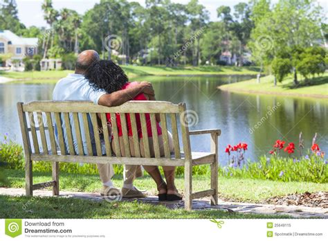 couple on park bench senior african american couple on park bench royalty free