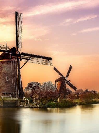 sunset river holland windmill wallpaper