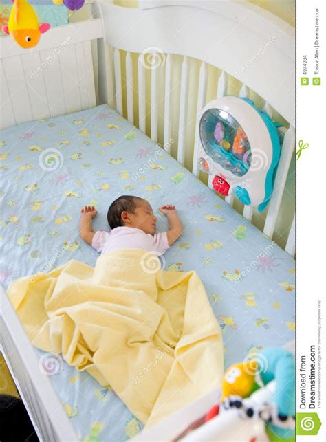 small baby bed small baby in big crib stock images image 4974934