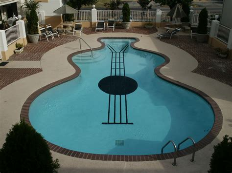 Guitar Shaped Swimming Pool | summery swimming pools with the most unusual shapes
