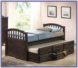 bed with bookcase and trundle interior design