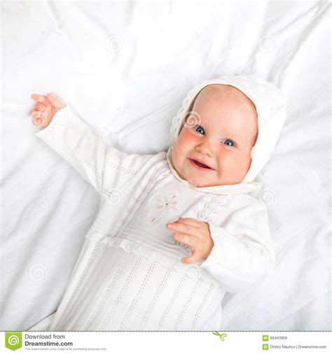 how to dress baby for bed child in baptismal clothes stock photo image 60443909