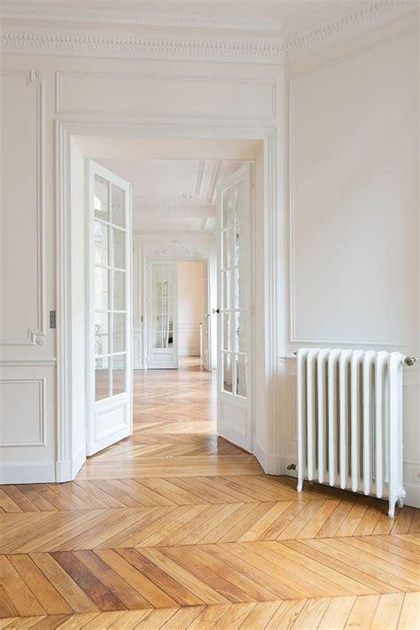 A Witty Entrance In A Parisian Apartment by Herringbone Floor Herringbone Glass