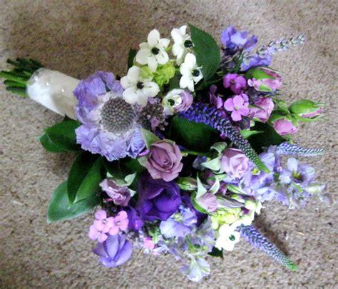 country garden wedding flowers held small bridemaid bouquet wedding flowers purple