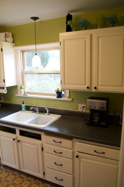 a quick fix for those ugly kitchen cabinets this was the painted countertops voila