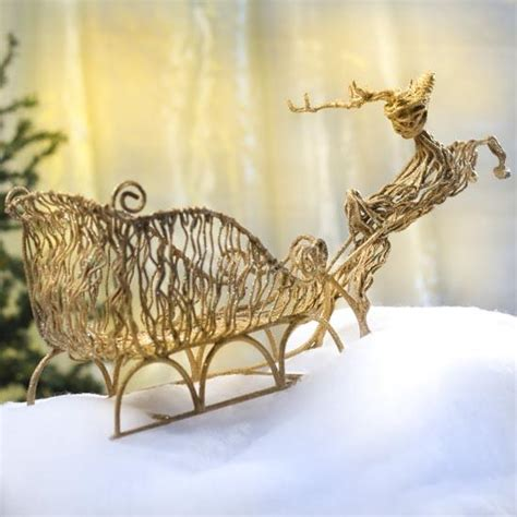 glistening gold grapevine flying reindeer and sleigh
