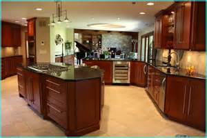 striking kitchen ideas with angled island with solid black granite countertops also stainless
