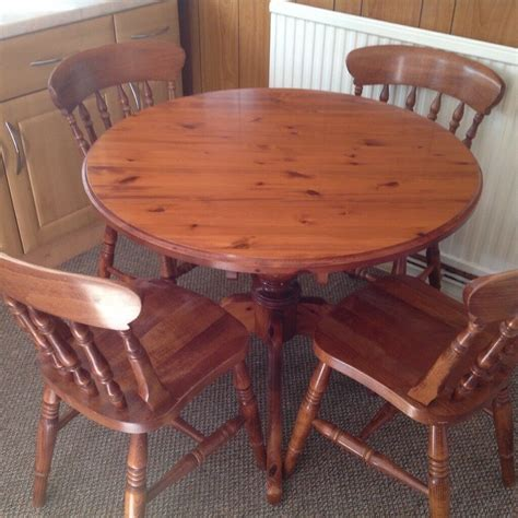 solid pine dining table and four chairs in stoke