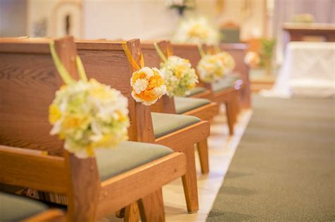 Green and yellow wedding theme, church aisle decorations
