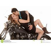 Couple Lay On Motorcycle Kiss Neck Stock Image