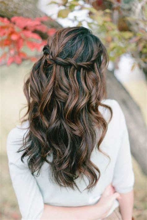 twisted balayage picture of a chic twisted halo wavy half updo looks