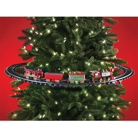 train track around christmas tree christmas lights