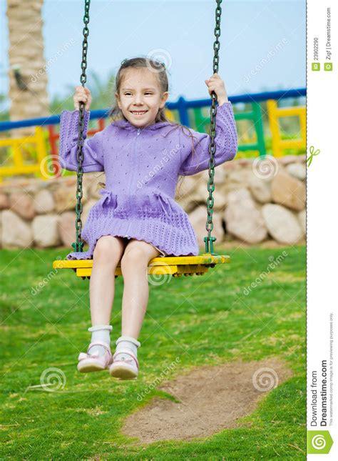 little girl on swing stock photo little girl sits on swing image 23902290