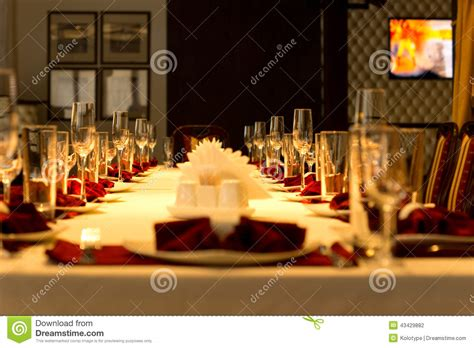 Dining Room Table Centerpiece dining table set with elegant place settings stock photo