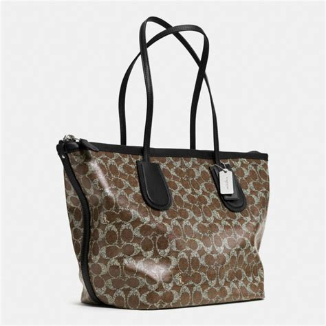 canvas zip tote lyst coach taxi zip top tote in signature coated canvas