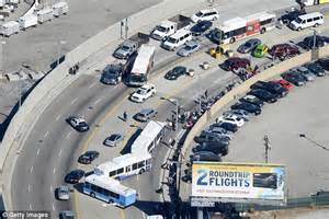 Car Rental On Atlanta Highway Travel Chaos At Lax As Hundreds Of Flights Are Grounded