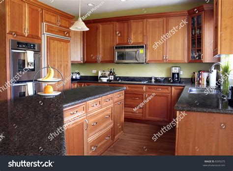 Stock Granite Countertops by Modern Kitchen With Cherry Cabinets And Granite