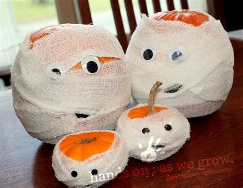 a pumpkin mummy halloween craft for the kids to make gauze googly eyes halloween