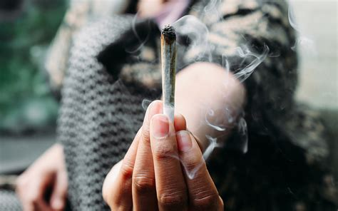 a woman smoking marijuana joints advice for first time cannabis smokers 10 tips to keep in
