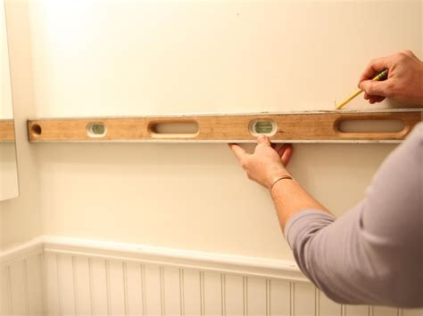 how to install bathroom towel bar step by step how to hang overhead storage in garage comfortable home design