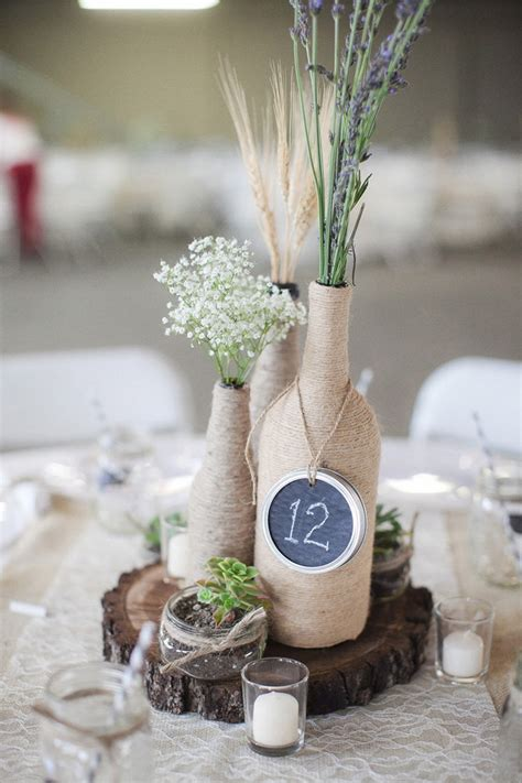 wedding centerpieces with wine bottles