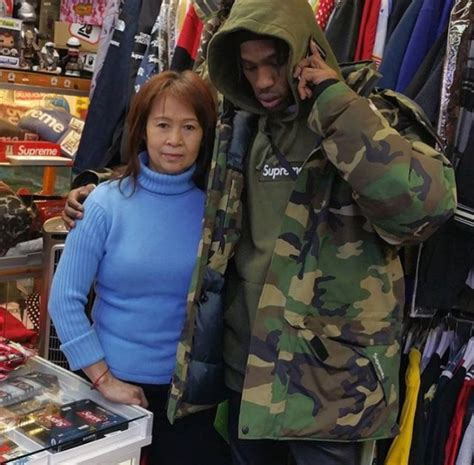 Jaket Telor Asin Bomber Parka Hodie travis poses wearing supreme parka jacket and hoodie
