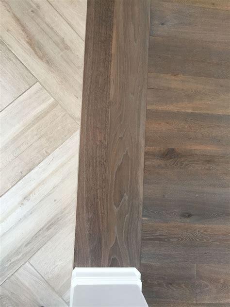 wood to tile transition floor transition laminate to herringbone tile pattern
